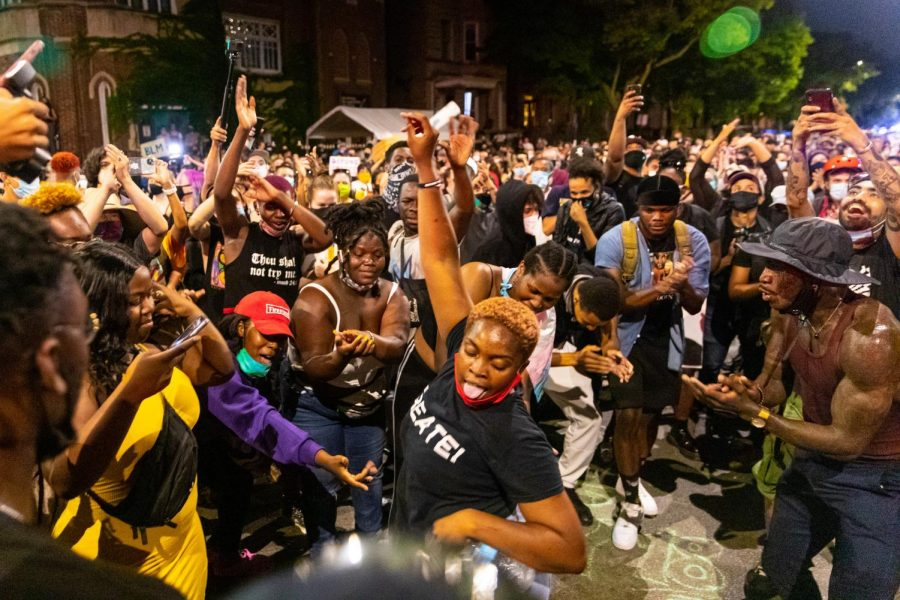 "Protestors gather for a dance party in front of Mayor Lori Lightfoot's Logan Square residence as a part of the ""Logan Square Lockdown,"" July 23, 2020."