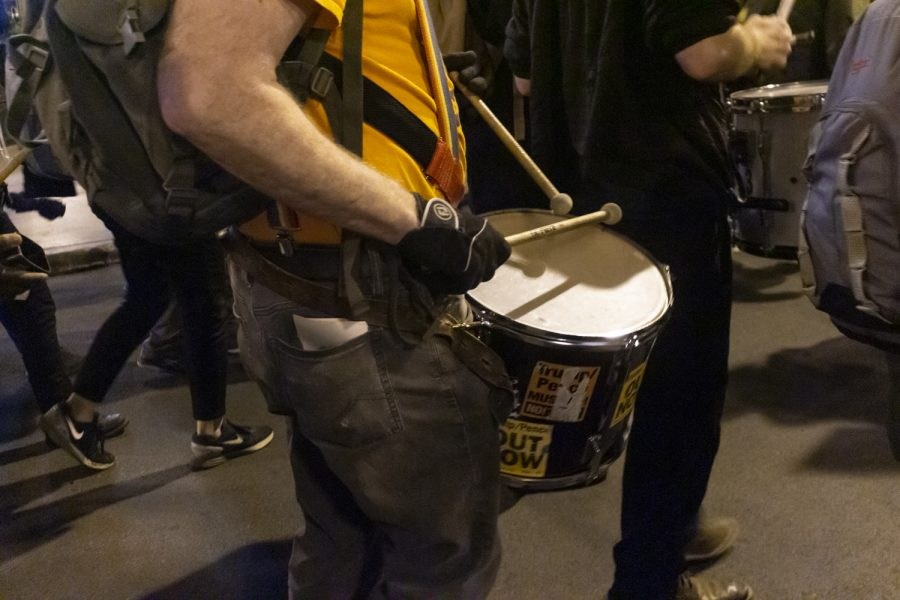 Roman Zabicki, member of The Drums of Justice and Refuse Fascism, keeps cadence with the crowd of protesters for the Defend the Election rally on Nov. 4.