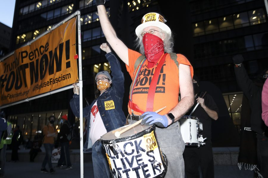 Drummer Roman Zabicki with the Drums of Justice and Refuse Fascism plays his drum at the Defend the Election rally in Daley Plaza.