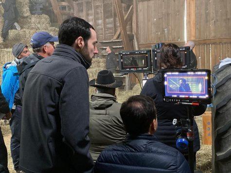 """Columbia alum Chris Charles (left) and adjunct faculty member Danny Kravitz (right) watch a scene from """"The Marksman"""" in action on the monitor."""