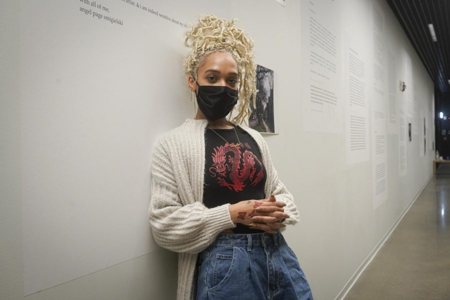 Angel Page Smigielski stands in front of their exhibit titled 70th & Throop on the fifth floor of the Student Center, 754 S. Wabash Ave, it is one of four exhibits in the Black Souls Welcome showcase