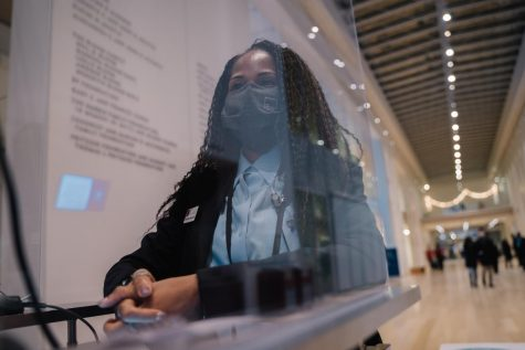 Senior photography major Constantina Davis is stationed at the entrance of the Modern Wing at The Art Institute of Chicago while on duty.