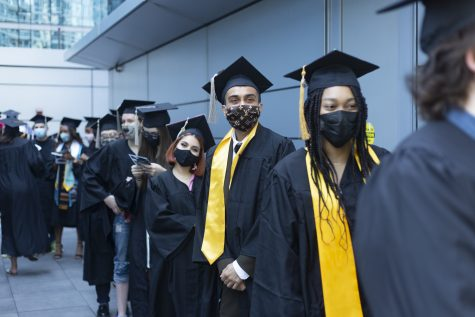 Columbia seniors prepare to walk and receive their mock diplomas at the student-run, in-person graduation ceremony at the Loews Hotel.