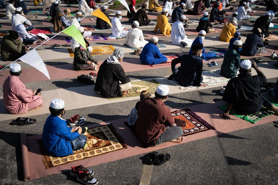 Muslims from Chicago's Rohingya community pray on Eid al-Fitr toward the Kaaba in Mecca from a parking lot at West Devon and North Washtenaw avenues.