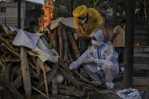 Bodies of COVID-19 victims are cremated in pyres as the country sees  its death total near 300,000 following an extreme outbreak over the past two months.