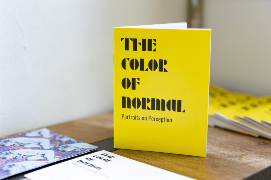 """A booklet with information on """"The Color of Normal"""" was available to the audience, which included quotes what about inspired the artist, information on the Juliet Art House and more."""