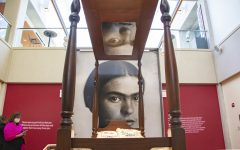 In front of a portrait of Frida Kahlo is displayed a replica of the bed from which she made a lot of her paintings after the bus accident. She used the mirror at the top of the bed to create self-portraits.