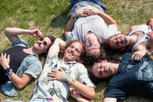 Chicago alt-rockers Post Animal sunbathe after their Thursday afternoon set.
