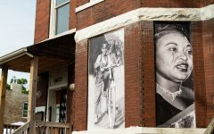 Photos of Emmett and Mamie Till hang on the windows of their former home in Chicago's Woodlawn neighborhood.