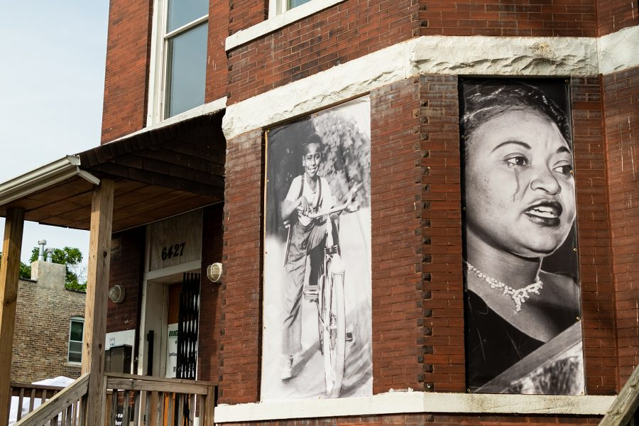 Photos of Emmett and Mamie Till hang on the windows of their former home in Chicago