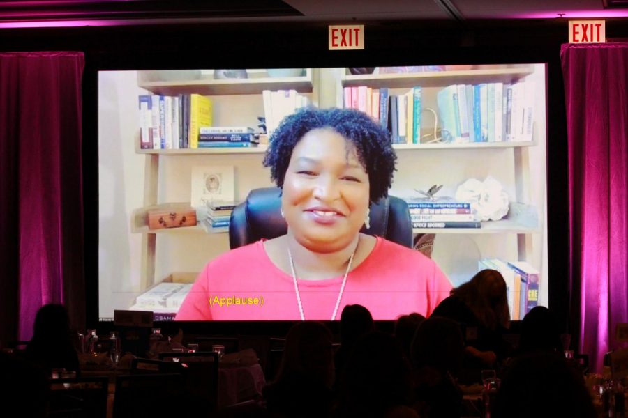 Former Georgia state legislator Stacey Abrams gets a welcoming round of applause from the crowd at the annual CFW luncheon.