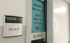 A sign displayed outside the United Staff of Columbia Colleges office at 600 S. Michigan Ave. calls for a salary increase for staff members.