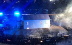 """A replica of West's childhood home stands at the center of Soldier Field for the """"DONDA""""  listening party."""