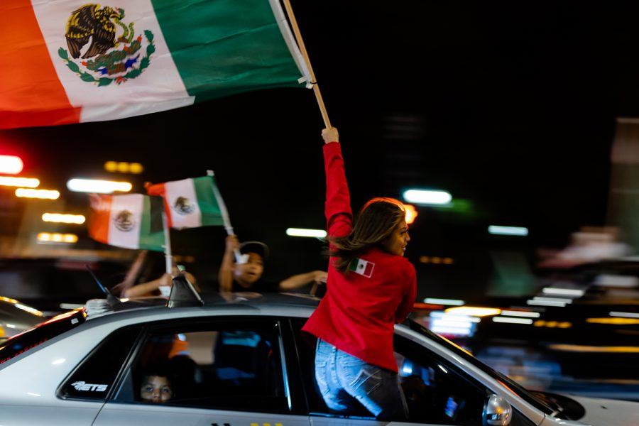 Hundreds of cars invade Michigan Avenue to shut down traffic and celebrate Mexican independence.