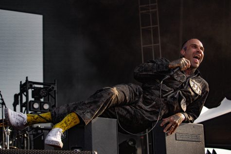Jason Alan Butler, lead singer of Fever 333, sings while lounging on musical equipment during their Sept. 19 performance.