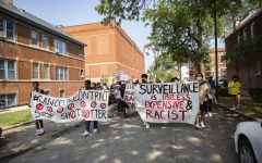 Little Village community members march west on 24th Street toward Ald. Michael D. Rodriguez's (22nd Ward) office, protesting the use of ShotSpotter in Chicago July 29.