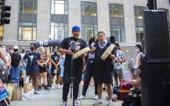 Winfield Wounded Eye and Adrien Pochel from Chi-Nations Youth Council perform at the Stop Line 3 protest in front of the U.S. Army Corps of Engineers' Chicago office, 231 S. LaSalle St.