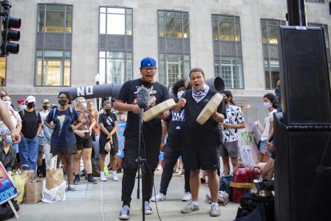 Winfield Wounded Eye and Adrien Pochel from Chi-Nations Youth Council perform at the Stop Line 3 protest in front of the U.S. Army Corps of Engineers