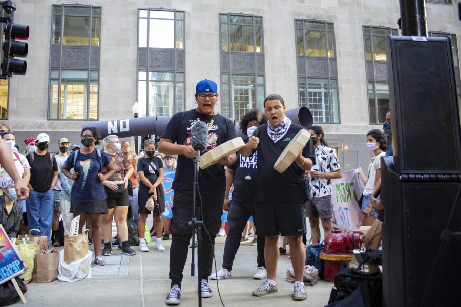 Winfield Wounded Eye and Adrien Pochel from Chi-Nations Youth Council perform at the Stop Line 3 protest in front of the U.S. Army Corps of Engineers Chicago office, 231 S. LaSalle St.
