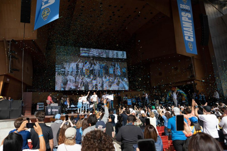 """The crowd chants """"Sky in four"""" as confetti floats around Pritzker Pavilion."""