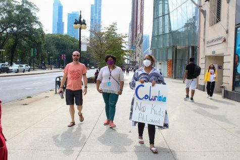 As the rally concluded, protesters walked along Michigan Avenue a final time, moments before Dr. Kim exited the 600 S. Michigan Ave. building.