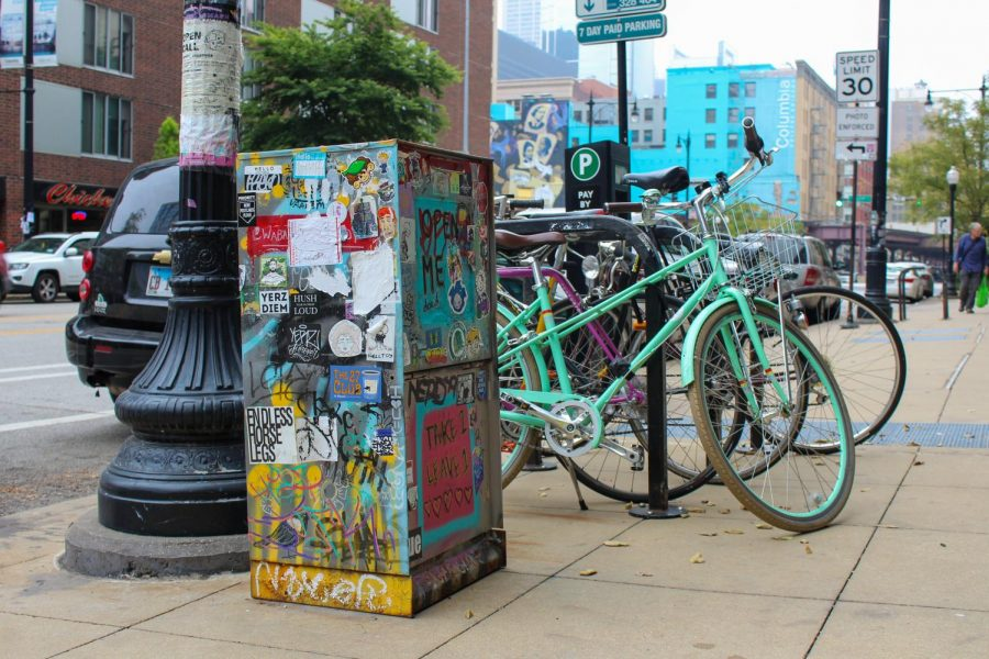 Anyone is welcome to pick up and trade artwork through the Wabash Art Drop, which sits outside of the 623 S. Wabash Ave. building decorated in stickers and artwork from current and former Columbia students.