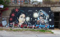 Marlen Ochoa-Lopez lived in Pilsen after immigrating to the U.S. She and her baby Yovanny Jadiel Lopez, who were both murdered, have a mural commemorating them, decorated with fresh flowers and a wooden cross for the two.