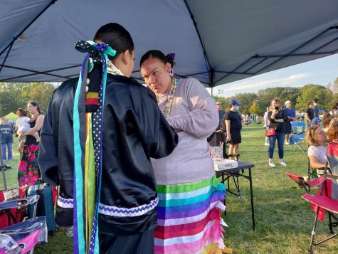 Aryana Robinson, 16, gets help preparing for the 68th Annual Chicago Powwow's evening Grand Procession, Oct. 9.