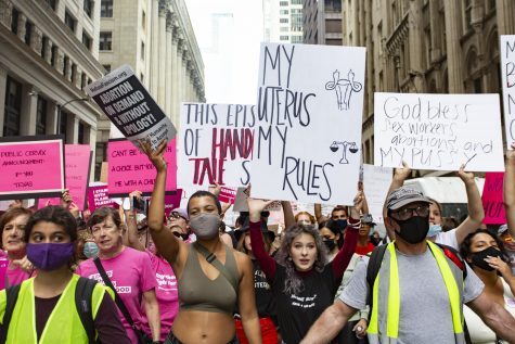 Marin Lorn and Isabelle Earl lead the march for abortion justice in Chicago on Oct. 2.